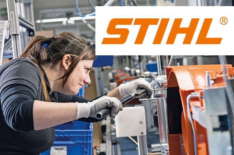 STIHL Tirol GmbH Mitarbeiterin mit Logo
