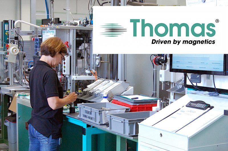 Thomas Magnete Mitarbeiterin mit Logo